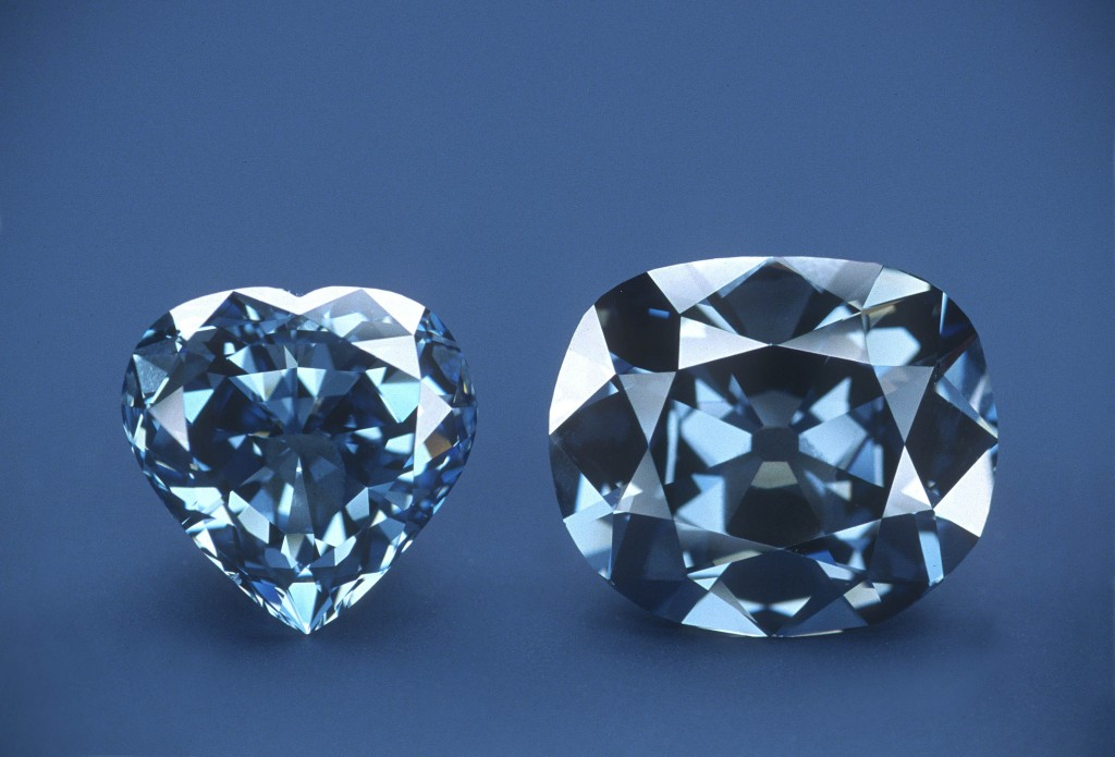 Photo: The Hope Diamond, right, without its white-diamond pendant, and the 30.62 carat Blue  Hart Diamond.