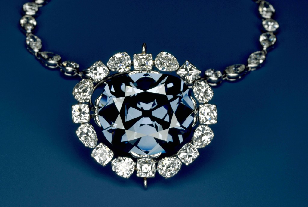 The 45.52 carat, deep-blue Hope Diamond is shown here inside its surrounding pendant of 16 pear- and cushion-cut white diamonds. (Photo by Chip Clark)