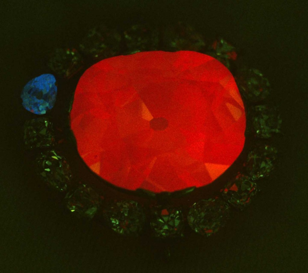 Photo: The Hope Diamond emits a red phosphorescence after being bombarded with ultraviolet light. (Photo by John Nels Hatleberg)