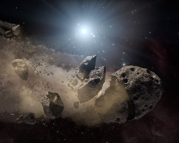 This artist's concept shows a white dwarf star surrounded by the bits and pieces of a disintegrating asteroid. Astronomers have found a white dwarf that shredded and gulped down an object the size of Ceres. (NASA/JPL-Caltech/T. Pyle )