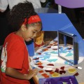 A child playing a puzzle game at the Lemelson Center