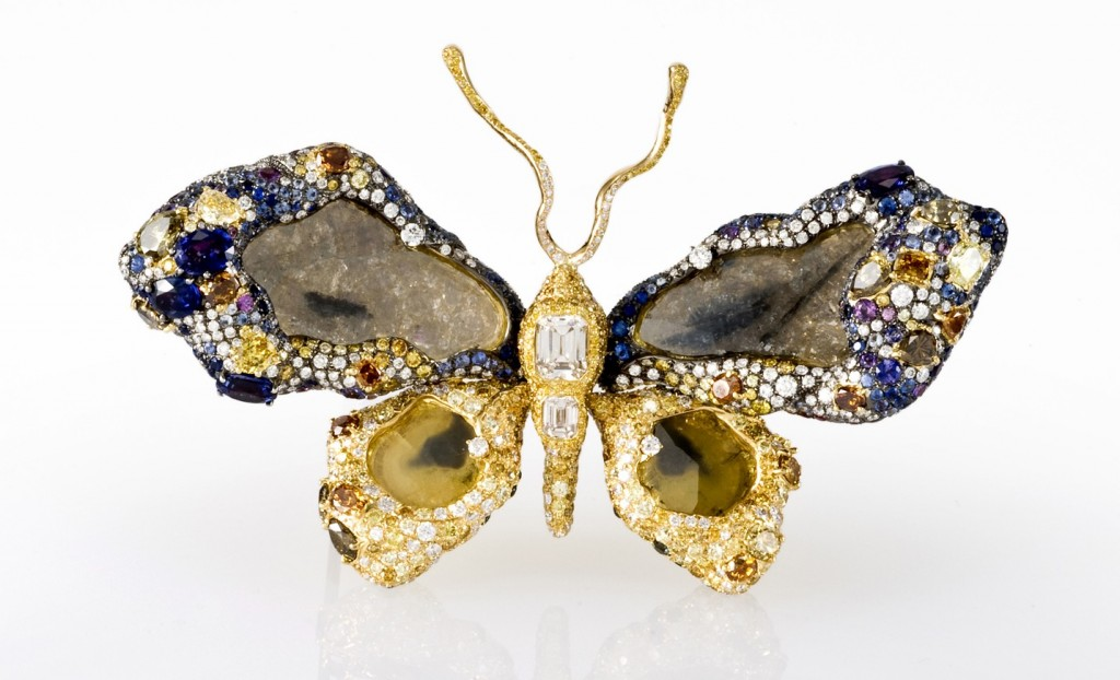 colorful brooch featuring diamonds and in the shape of a butterfly