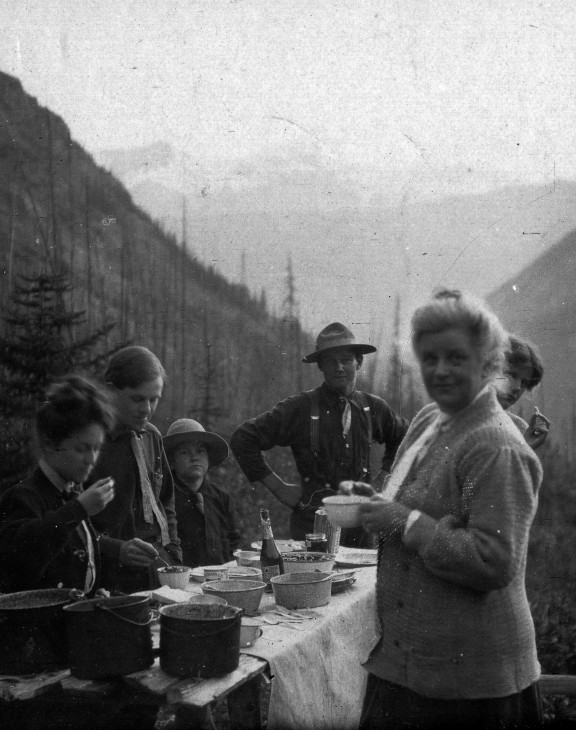 "Collecting trips for Charles Doolittle Walcott (1850-1927), paleontologist and fourth Secretary of the Smithsonian Institution, were often a family affair. This 1910 photograph shows their campsite in the Canadian Rockies. Shown are (left to right) Mrs. Burling, Dr. Lancaster Burling, son Benjamin Stuart Walcott (1895-1917), guide Otto, wife Helena Stevens Walcott (d. 1911), and daughter Helen Breese Walcott (1894-1965), peering from behind Helena Walcott. This photo from the Smithsonian Institution Archives appears in the Flickr photo set ""Women in Science."""