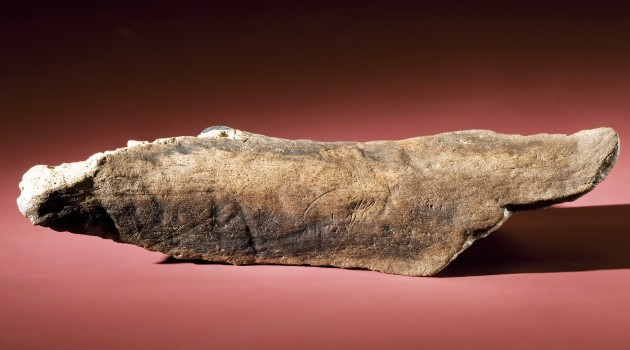 Mastodon bone inscribed with the image of a mastodon. Click to enlarge. (Photos by Chip Clark).