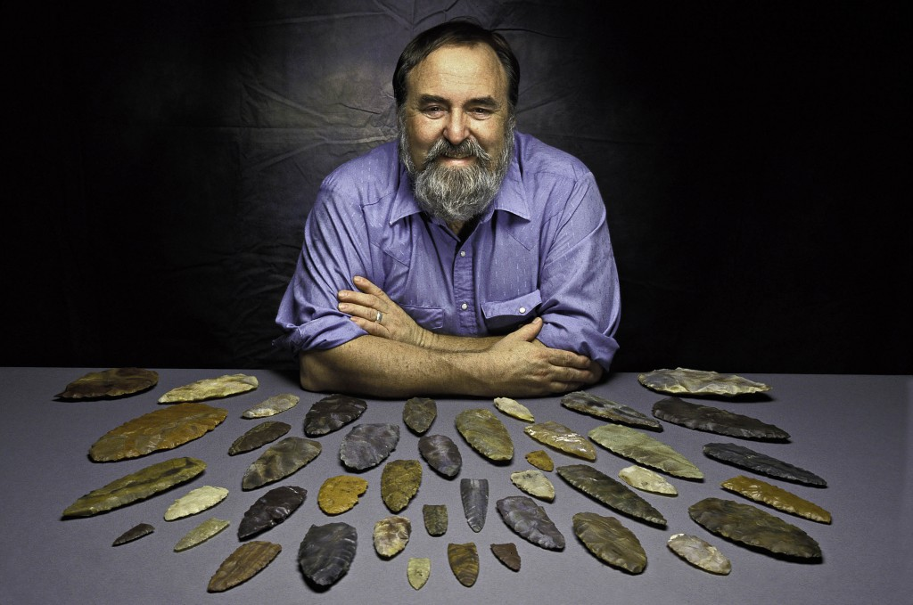 Image left: Dennis Stanford with Clovis stone points from the collection of the Smithsonian's National Museum of Natural History. (Photo by Chip Clark)