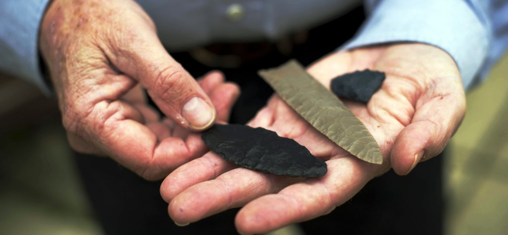 Image left: Clovis-made stone tools in the hands of Bruce Bradley, co-author of Across Atlantic Ice: The Origin of America's Clovis Culture. (Photo by Jim Wileman)