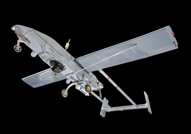 U.S. Army, Navy, and Marine units began using the RQ-2A drone, shown here, in the late 1980s to provide field commanders with real-time reconnaissance, surveillance, target acquisition, and battle damage information. Unlike an autonomous drone this drone was piloted by controllers on the ground with radio waves.  This one in the National Air and Space Museum collection operated from the battleship Wisconsin during the 1991 Gulf War. (Photo by Eric Long)