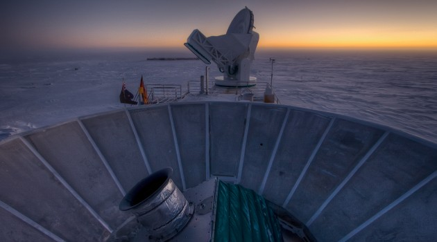 The sun sets behind BICEP2 (in the foreground) and the South Pole Telescope (in the background). (Photo by Steffen Richter, Harvard University)