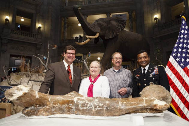 On April 15, 2014, the National Museum of Natural History welcomes the Nation's T. rex to the Smithsonian Institution. The Tyrannosaurus rex specimen, on loan from the U.S. Army Corps of Engineers, is the Museum's first nearly-complete T. rex skeleton, and will be the centerpiece of the Museum's renovated fossil hall slated to open in 2019. (From left) Kirk Johnson Ph.D., Sant Director, National Museum of Natural History, Smithsonian Institution; Kathy and Tom Wankel, the individuals who discovered the T.rex in Montana in 1988; and Lt. Gen. Thomas P. Bostick, Chief of Engineers and Commanding General, United States Army Corps of Engineers. (Photo by James Di Loreto / Smithsonian Institution)