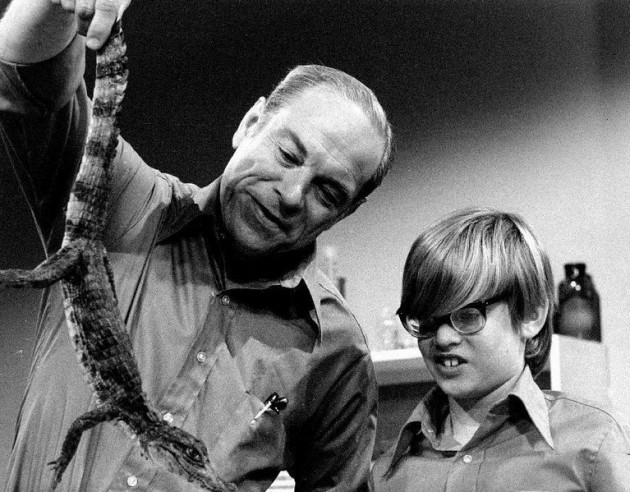 "Don Herbert, with a young assistant, exhibiting an example of ""Living Animal Fossils"" on ""Mr. Wizard"" in 1971."