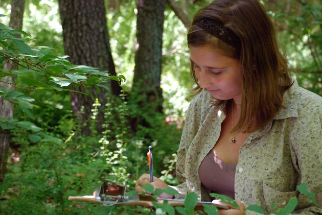A student records data at a research plot in U-M's Edwin S. George Reserve northwest of Ann Arbor. (Photo by Dale Austin)