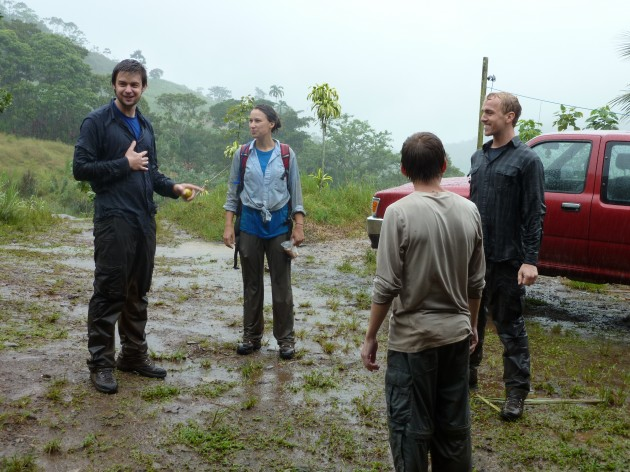 A group of field assistants gather to talk after checking live traps for mammals during the rainy season in Costa Rica. (Photo by S. Amanda Caudill)
