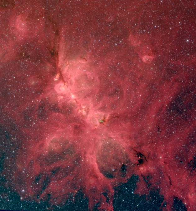 The Cat's Paw Nebula, also known as NGC 6334, comes alive in this infrared image from the Spitzer Space Telescope. A new study of this nebula finds that magnetic fields influence star formation on a variety of scales, from hundreds of light-years down to a fraction of a light-year. In this representative-color photo red shows light at a wavelength of 8 microns, green is 4.5 microns, and blue is 3.6 microns. (Image credit: S. Willis, CfA & NASA/JPL-Caltech/SSC)