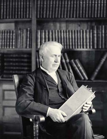 "Thomas Edison sits with one of his rechargeable nickel-iron batteries. Frustrated by design flaws that led to a 5-year recall and redesign, Edison wrote in a letter to his wife that he hoped ""there will be no batteries in heaven."" (Photo: Wikimedia Commons)"