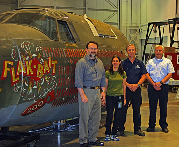 With Flak-Bait front fuselage, conservation team members from left, Jeremy Kinney, Lauren Horelick, Pat Robinson and Chris Moore. (Photo by Michelle Z. Donahue)