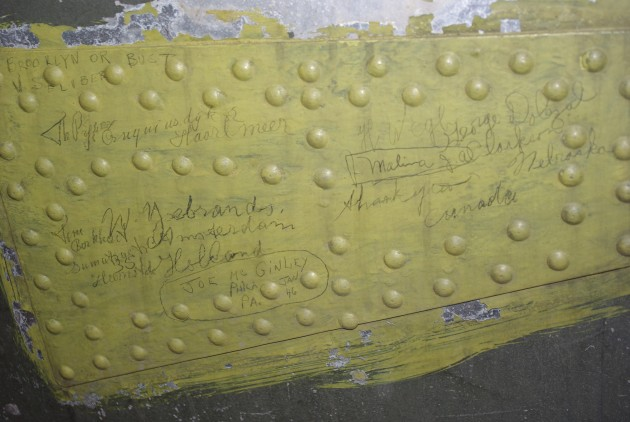 Many surfaces of the B-25 Marauder bear the penciled autographs of service members. Flak-Bait was a celebrity by the end of World War II; soldiers left their mark as proof they'd met a star. (Photo by Michelle Z. Donahue)
