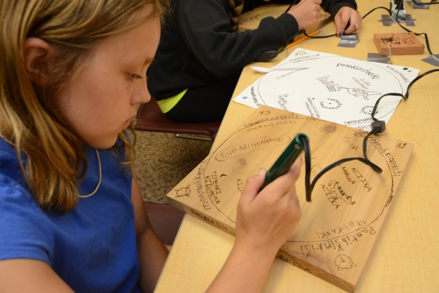 Myaamia tribe member Dahra Sirois works on a language and craft project during the Eewansaapita summer camp in Fort Wayne, Indiana. (Photo by Andrew J. Strack, courtesy Myaamia Center Archive)