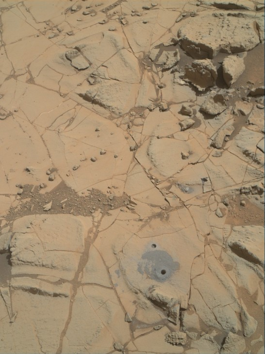 "Gray cuttings from drilling by NASA's Curiosity Mars rover into a target called ""Mojave 2"" are visible surrounding the sample-collection hole in this image from the rovers' Mars Hand Lens Imager (MAHLI) camera. This site in the ""Pink Cliffs"" portion of the ""Pahrump Hills"" outcrop provided the mission's second drilled sample of layered rock forming the base of Mount Sharp."