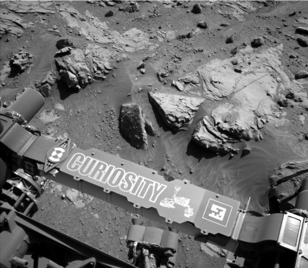 "This image from the Navigation Camera on NASA's Curiosity Mars rover shows a sandstone slab on which the rover team has selected a target, ""Windjana,"" for close-up examination and possible drilling. The target is on the approximately 2-foot-wide (60-centimeter-wide) rock seen in the right half of this view. The Navcam's left-eye camera took this image during the 609th Martian day, or sol, of Curiosity's work on Mars (April 23, 2014). The rock is within a waypoint location called ""the Kimberley,"" where sandstone outcrops with differing resistance to wind erosion result in a stair-step pattern of layers."