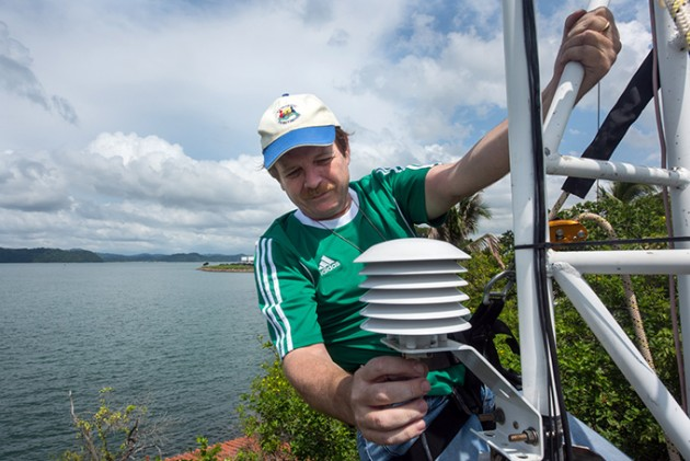 STRI's director of physical monitoring, Steve Paton, checks the metrological tower at Punta Culebra, Panama. (Photo by Sean Mattson).