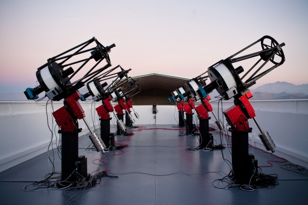 The MEarth-South telescope array, located on Cerro Tololo in Chile, searches for planets by monitoring the brightness of nearby, small stars. This photograph shows the array, comprising eight 40-cm telescopes, at twilight. (Photo by Jonathan Irwin)