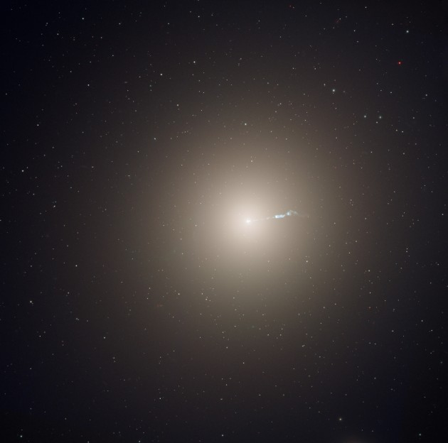 "The monstrous elliptical galaxy M87, located 53 million light-years from Earth is the dominant galaxy at the center of the neighboring Virgo cluster of galaxies. Astronomers have measured the ""heartbeats"" of stars within M87 and used that data to determine the galaxy's age in a new way. This photograph was taken with the Hubble Space Telescope's Advanced Camera for Surveys instrument. (Image by NASA, ESA, and the Hubble Heritage Team)"