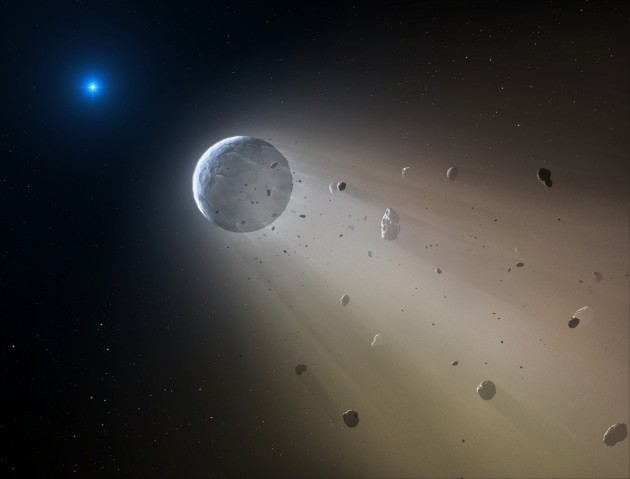 In this artist's conception, a Ceres-like asteroid is slowly disintegrating as it orbits a white dwarf star. Astronomers have spotted telltales signs of such an object using data from the Kepler K2 mission. It is the first planetary object detected transiting a white dwarf. Within about a million years the object will be destroyed, leaving a thin dusting of metals on the surface of the white dwarf. (Image by Mark A. Garlick)