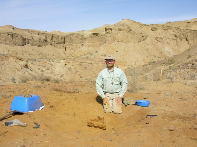 Hans Sues excavating a dinosaur fossil