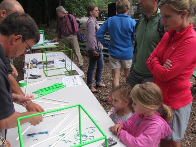 Visitors assemble a BioCube