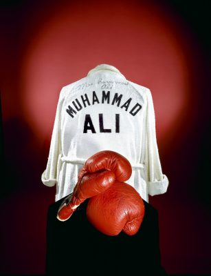 "In 1976 the Smithsonian acquired Ali's boxing gloves and robe for an exhibition on the American Bicentennial,""A Nation of Nations."" At the donation ceremony, before a crowd of reporters and cheering spectators, Ali predicted that his Everlast gloves would become""the most famous thing in this building."""