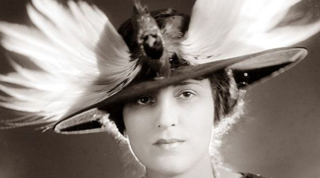 Woman in a feather hat.