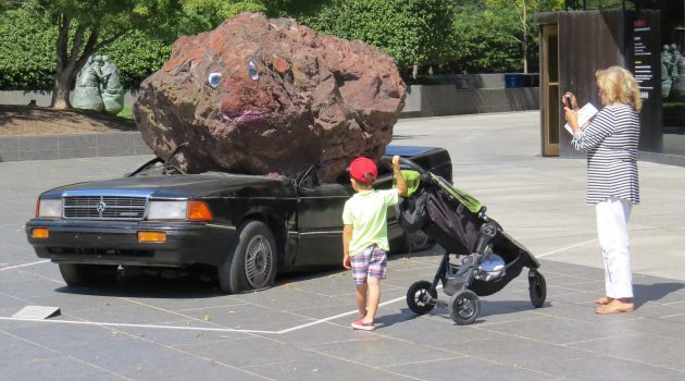 On Hirshhorn plaza, demolished '92 Dodge keeps pulling in the curious
