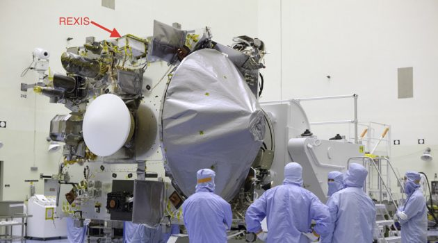 A photograph of the OSIRIS-REx spacecraft prior to installation of thermal blankets. The REXIS instrument is labelled. (Image courtesy NASA)