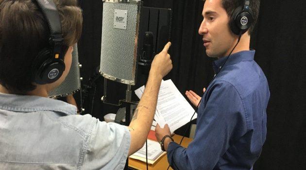 Tony Cohn in the studio recording a podcast.