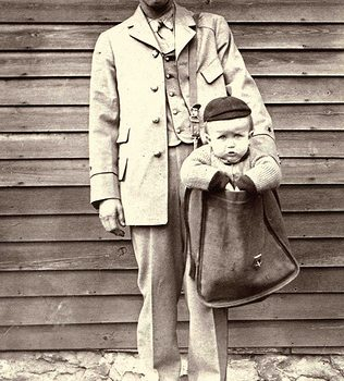 """Carriers had fun with the idea of """"mailing"""" babies and staged these photographs. This image is a part of a collection of Smithsonian photographs on Flickr and the most popular photograph from the Institution in that collection."""