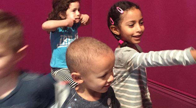 "In a section of the new children's space at the Portrait Gallery, ""Strike a Pose,"" children act out different portrait poses. (National Portrait Gallery photo)"