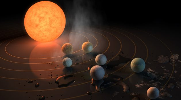 Two separate teams of scientists from the CfA have identified major challenges for the development of life in TRAPPIST-1. The TRAPPIST-1 system, depicted here in an artist's conception, contains seven roughly Earth-sized planets orbiting a red dwarf, which is a faint, low-mass star. This star spins rapidly and generates energetic flares of ultraviolet radiation and a strong wind of particles. The research teams say the behavior of this red dwarf makes it much less likely than generally thought that the three planets orbiting well within the habitable zone could support life. (Image courtesy NASA/JPL-Caltech/R. Hurt)