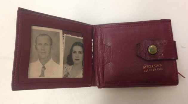 aria Halloran's wallet with photos of her parents that she brought with her from Cuba. (Courtesy of the National Museum of American History)