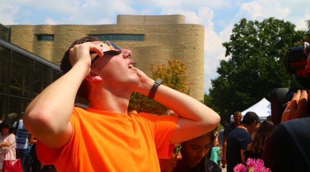 Visitors at the National Air and Space Museum gather to view the solar eclipse on Monday, Aug. 21. (Photo by Guilène Assamoi)