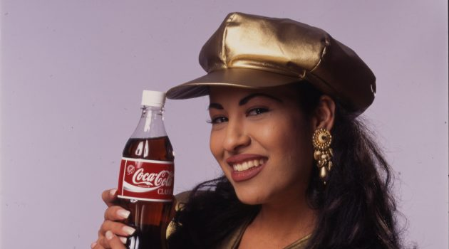 Selena in gold lamé top with matching hat, 1994.  Photo by Al Rendon, Collection of the Smithsonian's National Museum of American History