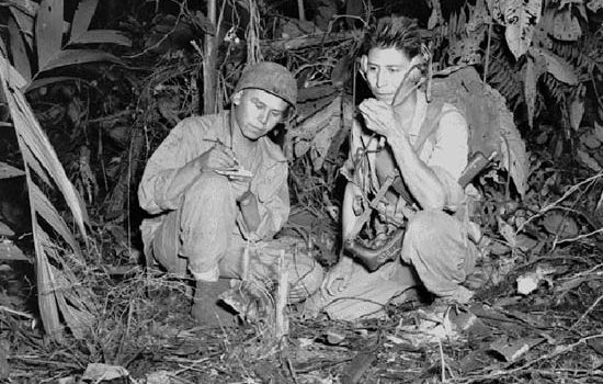 Navajo Code Talkers Corporal Henry Bake, Jr. (left) and Private First Class George H. Kirk operating a portable radio set at Bougainville, an island in the South Pacific, in December 1943.