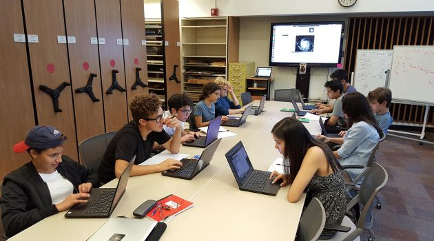 High school students in the first cohort of the Science Research Mentoring Program learn how to work with astronomical images in the Harvard-Smithsonian Center for Astrophysic's Wolbach Library.