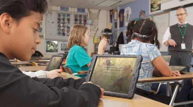 Students access Native Knowledge 360 on-line learning materials during a classroom lesson.