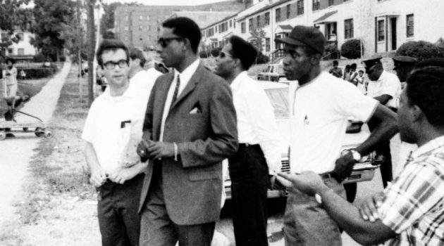 Black Power activist Stokely Carmichael, (2nd from left), visiting Barry Farm Dwellings in 1967 with community organizers from the Southeast Neighborhood House, including Phil Perkins (far left). (Image courtesy Anacostia Community Museum Archives, Smithsonian Institution